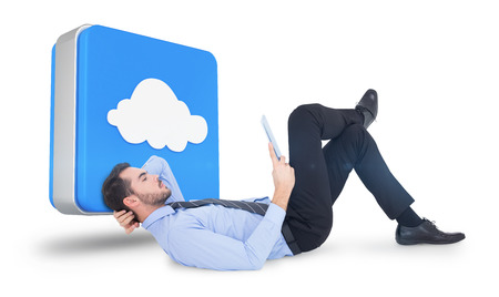 using tablet: Businessman lying on floor using tablet  against cloud computing tile