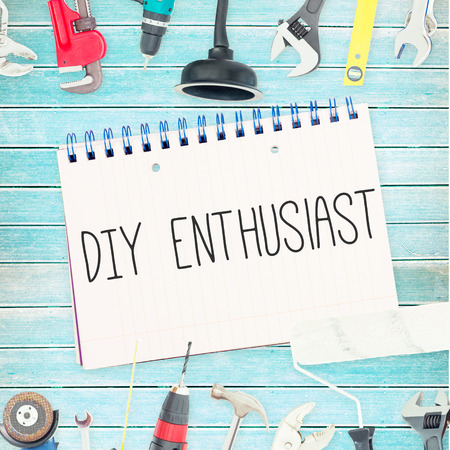 enthusiast: The word diy enthusiast against tools and notepad on wooden background Stock Photo