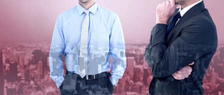 frowning: Frowning businessman thinking  against high angle view of city Stock Photo
