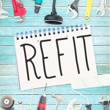 refit: The word refit against tools and notepad on wooden background Stock Photo