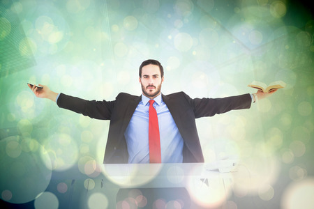 unsmiling: Unsmiling businessman sitting with arms outstretched against blue abstract light spot design