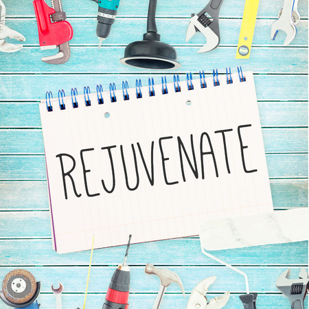 rejuvenate: The word rejuvenate  against tools and notepad on wooden background