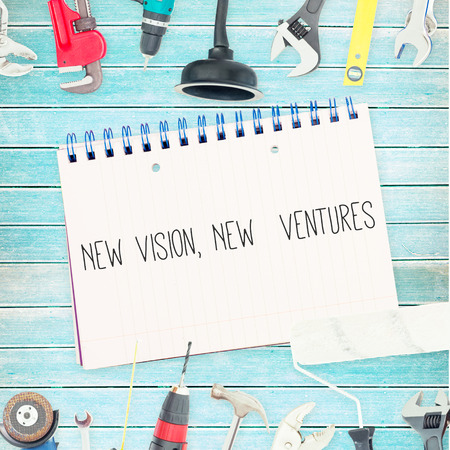 ventures: The word new vision, new  ventures against tools and notepad on wooden background