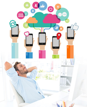 resting: Casual man resting with hands behind head in office against smartphones connecting to cloud