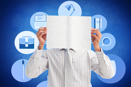 handholding: Businessman holding a white card covering his face against blue background Stock Photo