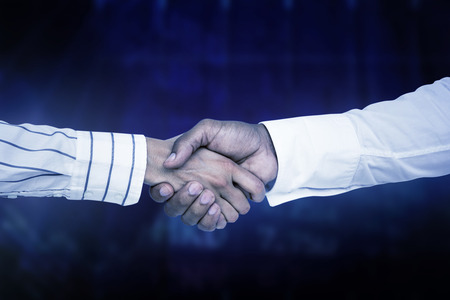 stocks and shares: Business people shaking hands against stocks and shares Stock Photo