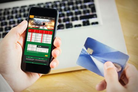 gambling: Businessman using smartphone against gambling app screen