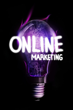 glowing light bulb: online marketing against glowing light bulb Stock Photo
