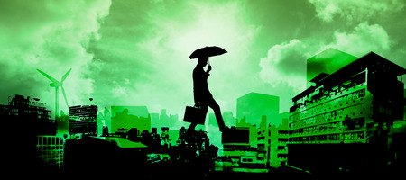 stepping: Businessman stepping against green sky over city