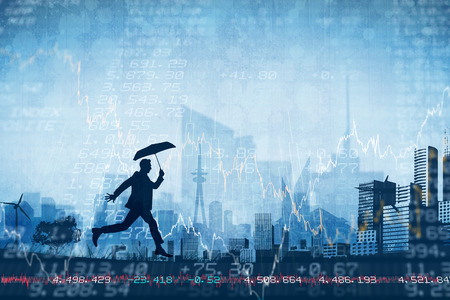 stocks and shares: Businessman with umbrella against stocks and shares Stock Photo