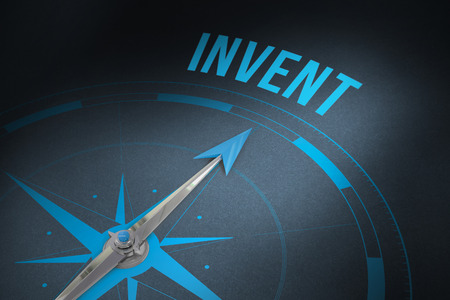 invent: The word invent and compass against grey background