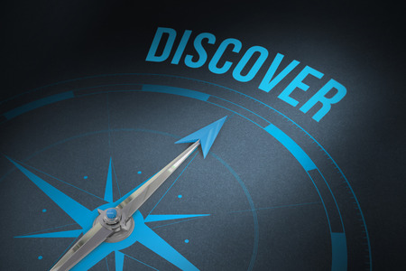 discover: The word discover and compass against grey