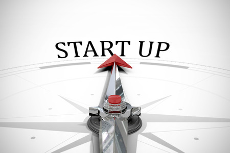 start up: The word start up against compass