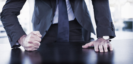 thump: Angry businessman thump the table in his office