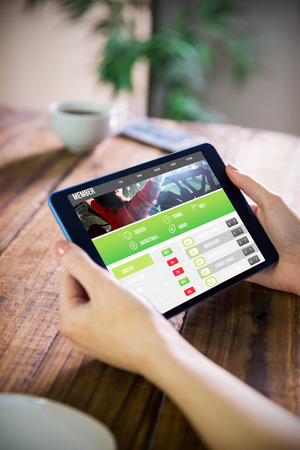 using tablet: Woman using tablet pc  against gambling app screen Stock Photo