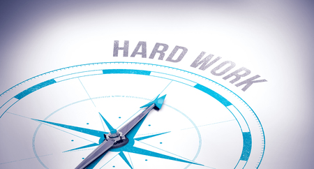 hard way: The word hard work against compass