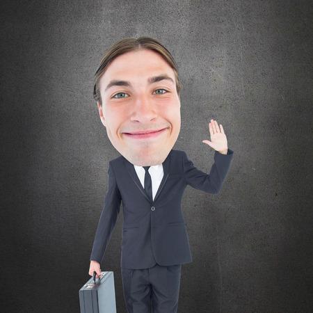 geeky: Geeky businessman waving against grey room Stock Photo