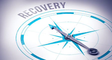 recovery: The word recovery against compass Stock Photo