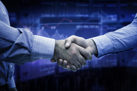 share information: Men shaking hands against stocks and shares