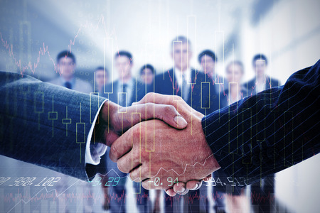 market share: Business people shaking hands against stocks and shares Stock Photo