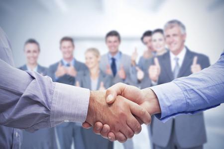 男性握手の合成画像 写真素材