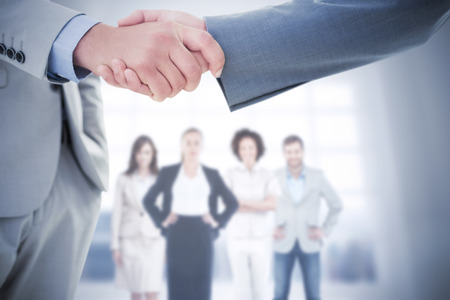 introduction: Composite image of business handshake