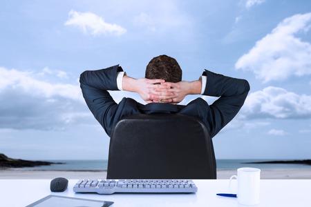 swivel chair: Businessman sitting in swivel chair  against beach Stock Photo