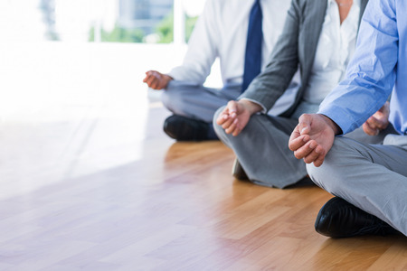 yoga man: Close up view of business people doing yoga in office