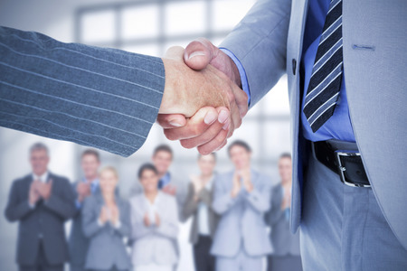 co: Composite image of  businessman shaking hands with a co worker