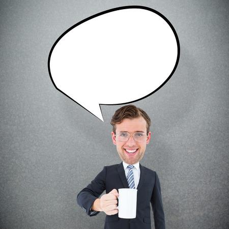 geeky: Geeky businessman holding mug against grey background