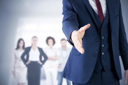Immagine composita di uomo d'affari pronto a stringere la mano