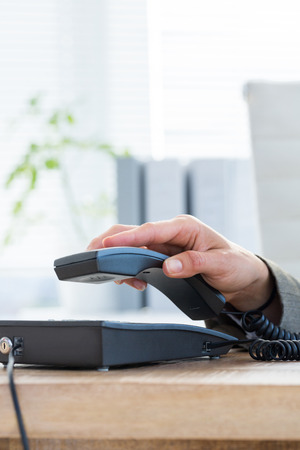 answer phone: Businessman answer the phone at the office