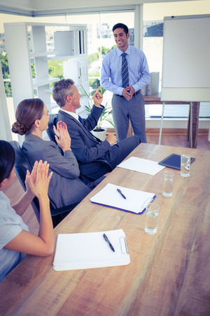 acclamation: Business people applauding during a meeting in the office