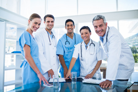 Doctors and nurses smiling at camera in medical office