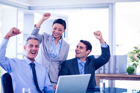 acclamation: Happy business people cheering together in office