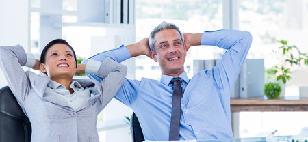swivel: Business people relaxing in swivel chair in office Stock Photo