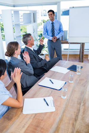 applauding: Business people applauding during a meeting in the office