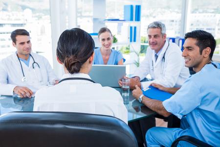 medical doctors: Doctors having a meeting in medical office