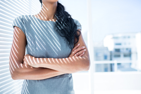 arms folded: Close up view of businesswoman with arms folded in the office