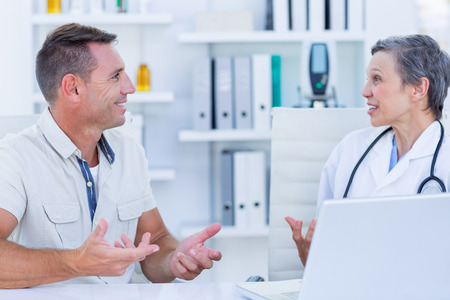 patient doctor: Female doctor speaking with her patient in medical office