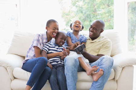 home  life: Happy smiling family on the couch in the living room