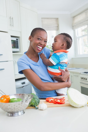 babyboy: Happy smiling mother with his babyboy in the kitchen