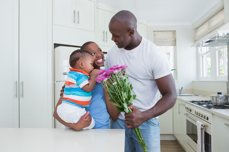 babyboy: Happy smiling couple with his babyboy in the kitchen Stock Photo