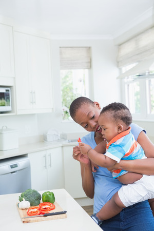 babyboy: Happy smiling mother with babyboy son in the kitchen