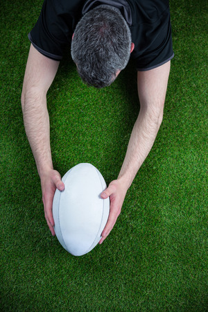 scoring: Upward view of a rugby player scoring a try