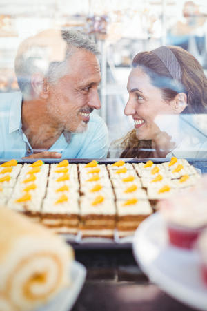 each other: Cute couple looking at each other in the bakery store