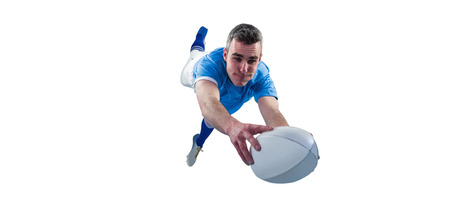 to try: A determined rugby player scoring a try Stock Photo