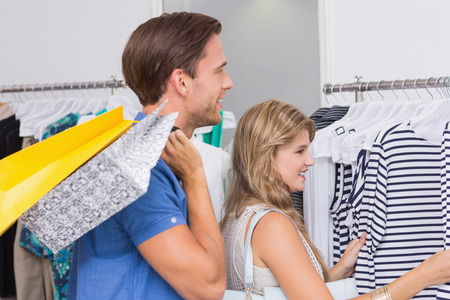 clothing store: A happy couple with shopping bags in the clothing store Stock Photo