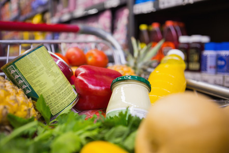 grocery shelves: A trolley with healthy food at supermarket Stock Photo