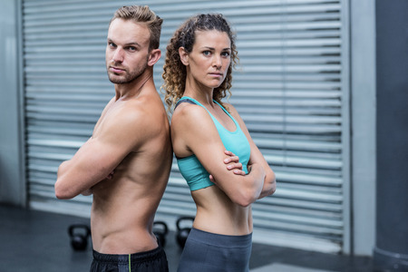 giving back: Portrait of an attentive muscular couple giving back to back